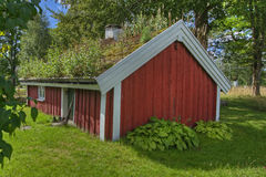 An old cottage, log cabin from the 1800s in Sweden... in HDR Royalty Free Stock Images