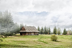 Old cottage in the mountains. And dark sky Stock Images