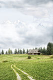 Old cottage in the mountains. And dark sky Stock Photo
