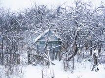 Old cottage near the Verkhnedneprovsky village. Winter landscape. Old cottage near the village of Verkhnedneprovsky, Smolensk region, Russia. Winter snowy Stock Photos