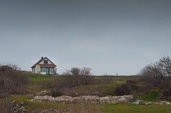 Old cottage. Rural old cottage on a hill Stock Images