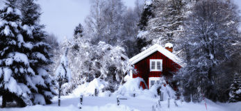 Old cottage set in a snowy winter landscape Stock Photography