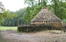 Old cottage under thatched roof. Settlement, former buildings, house with thatched roofs Royalty Free Stock Photography