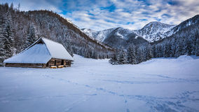 Old cottage in winter mountains Royalty Free Stock Images