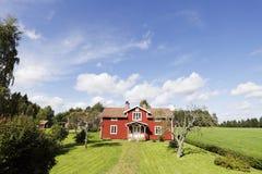 Old cottages and landscape Stock Images