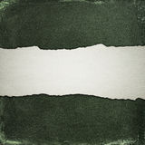 Old cotton background with strip of torn paper Stock Photos