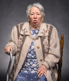 Old coughing woman Stock Photo