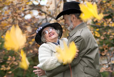 Old coule in autumnal park Stock Photography
