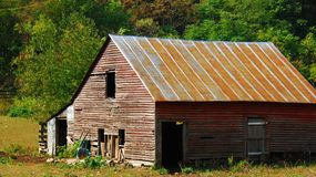 Old Country Barn. Here is a picture of an old country barn located in the back woods of Virginia Royalty Free Stock Image