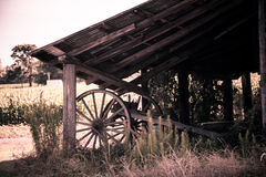 Old Country Barn, with a vintage Plow underneath. Old Country Barn on the old manning road near a spot called Live Oak, which is lush, green, and covered with royalty free stock photos