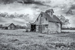Old Country Barns. Cloudy Sky Over Old Barns stock photography