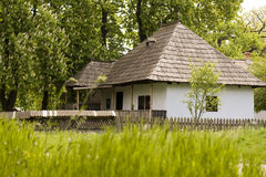 Old country house. In green field Royalty Free Stock Photography