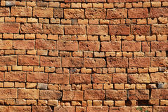 Old country house brick wall. Old country house red brick wall as background stock photo