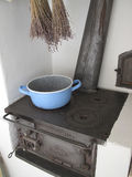 Old country house kitchen. Stove and pot in an old country house kitchen royalty free stock images