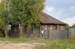 Old country log house with wooden roof Royalty Free Stock Photo