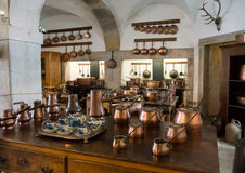 Old country style kitchen with copper pots Royalty Free Stock Photo