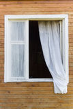 Old country-style window. Old traditional country-style window in a wooden house (with a white curtain Stock Photos