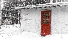 Old country utility storage shed surrounded in snow in Canadian eastern Ontario winter. Stock Images