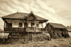 Old countryside house and an old barn in a Romanian village Royalty Free Stock Image