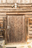 Old countryside house wooden wall details with cow skull Stock Photography