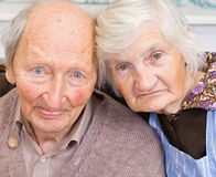 Old couple. Old happy grandparents staying together on the bed Royalty Free Stock Photos