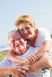 Old couple. Happy loving old couple hugging outdoors stock image