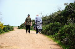 Old couple. An old couple walk on a path Stock Image