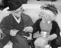 Old Couple. Black and white image of old couple models having a couple of tea Stock Photos
