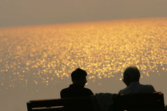 The old couple. The old coouple in the sunset aside the lake beijing Royalty Free Stock Image