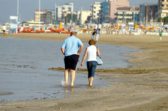 Old couple. Walking by Adriatic coast, Bellaria, Italy Royalty Free Stock Photos