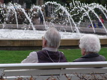 Old couple. Fountain and couple Royalty Free Stock Photography