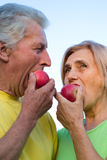 Old couple with apples Royalty Free Stock Images