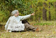 Old couple at autumn park Royalty Free Stock Photo