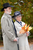 Old couple in autumnal park Royalty Free Stock Photography