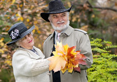 Old couple in autumnal park Royalty Free Stock Photos