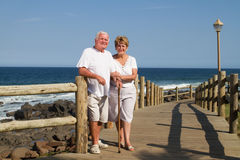 Old couple on beach Stock Photo