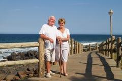 Old couple on beach Stock Photo
