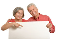 Old couple with board Stock Images