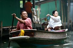 Old couple in the boat in floating village Royalty Free Stock Images