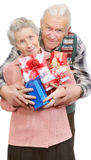 Old couple and boxes with gifts Royalty Free Stock Photography