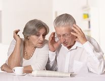 Old couple at breakfast. Cute old couple at breakfast at table royalty free stock image