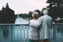 Old couple on bridge Stock Images