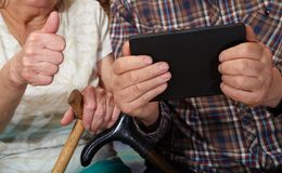 Old couple and computer. Ok. Senior people health care Stock Image