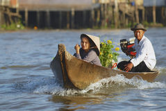 Old couple cross Mekong river by motorboat, Cai Be, Vietnam. Royalty Free Stock Image