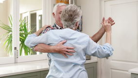 Old couple dancing a waltz. At home stock footage