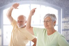 Old couple doing exercises royalty free stock photos