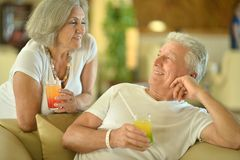 Old couple drink juice Stock Photo