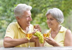 The old couple drinking wine Stock Photo