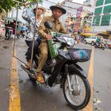 Old couple driving their motorbike in Phnom Penh Royalty Free Stock Images