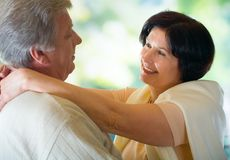Old couple embracing Stock Images